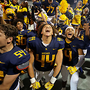 Whitmer players celebrate their routing of St. John's Jesuit in high school football at Whitmer in Toledo on Friday, Sept. 24, 2021. THE BLADE/KURT STEISS