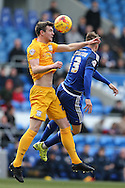 Paul Huntington of Preston North End (l) jumps for a header with Anthony Pilkington of Cardiff city. Skybet football league championship match, Cardiff city v Preston NE at the Cardiff city stadium in Cardiff, South Wales on Saturday 27th Feb 2016.<br /> pic by  Andrew Orchard, Andrew Orchard sports photography.