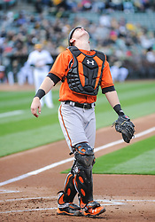 May 5, 2018 - Oakland, CA, U.S. - OAKLAND, CA - MAY 05: Baltimore Orioles catcher Chance Sisco (15) looks up at the sky for a pop up near home plate during the regular season game between the Oakland Athletics and the Baltimore Orioles on May 5, 2018 at Oakland-Alameda County Coliseum in Oakland,CA (Photo by Samuel Stringer/Icon Sportswire) (Credit Image: © Samuel Stringer/Icon SMI via ZUMA Press)