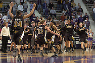 The Missouri Tigers celebrate as they comeback from 19 points down in the second half and beat Kansas State 66-65 in overtime at Bramlage Coliseum in Manhattan, Kansas, February 1, 2006.