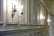 wall lights burning in elegant hall