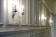 wall lights burning in elegant hall