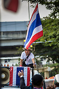27 NOVEMBER 2013 - BANGKOK, THAILAND: Protestors ride in a pickup truck with a Thai flag into the Ministry of Finance in Bangkok. There is still no sign of police or security personnel at the ministry and there has been no effort to expel protestors. Anti-government protestors continue to occupy the Ministry of Finance in Bangkok. Protests also spread to other government ministries and several provinces in southern Thailand, a stronghold of the opposition.       PHOTO BY JACK KURTZ