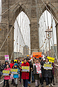 Marchers beneath the arches of the Brooklyn Birdge on their way to Manhattan. In the front row on the right is Shannon Watts, foudner of One Million Moms.