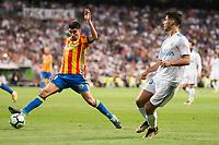 Real Madrid's Marco Asensio and Valencia's Alvaro Medran during La Liga match between Real Madrid and Valencia CF at Santiago Bernabeu Stadium in Madrid, Spain August 27, 2017. (ALTERPHOTOS/Borja B.Hojas)