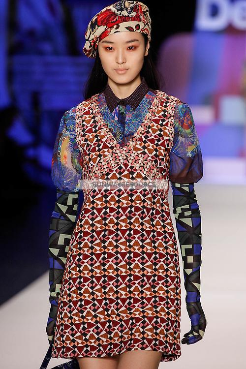 Yue Han walks the runway wearing Desigual Fall 2016 during New York Fashion Week on February 11, 2016