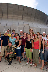31st August, 2005. New Orleans, Louisiana.<br /> 'Hell on earth.' The Superdome in New Orleans, Louisiana where over 20,000 refugees from hurricane Katrina are crammed into hellish conditions. Tourists trapped by the storm pose with Staff Sgt Garland Ogden - their saviour. Ogden pulled them out of the hell that is the Superdome after they received increasing threats.<br /> Photo Credit: Charlie Varley/varleypix.com