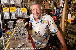 Arlin Fatland behind the counter for the last bike week his 2-Wheelers shop will be open on Main Street during Daytona Beach Bike Week, FL. USA. Sunday, March 10, 2019. Photography ©2019 Michael Lichter.