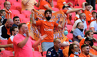 Blackpool fans watch their team in action<br /> <br /> Photographer Chris Vaughan/CameraSport<br /> <br /> The EFL Sky Bet League One Play-Off Final - Blackpool v Lincoln City - Sunday 30th May 2021 - Wembley Stadium - London<br /> <br /> World Copyright © 2021 CameraSport. All rights reserved. 43 Linden Ave. Countesthorpe. Leicester. England. LE8 5PG - Tel: +44 (0) 116 277 4147 - admin@camerasport.com - www.camerasport.com