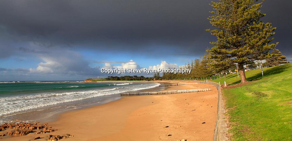 Torquay's Cosy Corner  <br /> Sunny break with a stormy sky<br /> pics  Steve Ryan