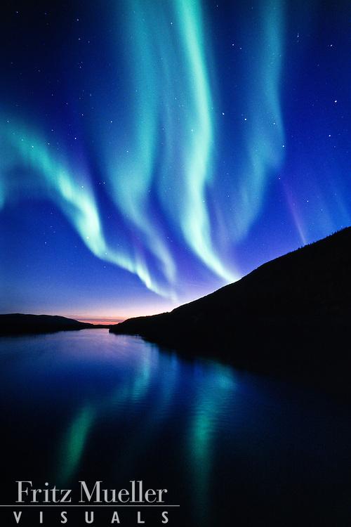 Aurora borealis reflected in the Stewart River, Central Yukon