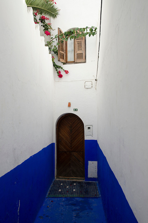A typical narrow alley in Asilah, Morocco