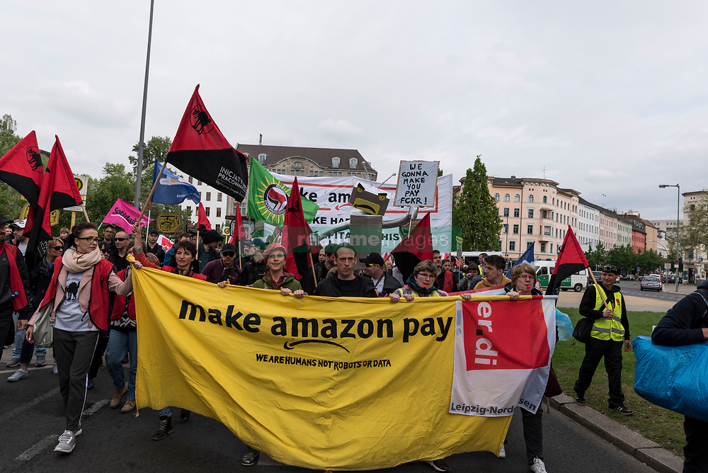 April 24, 2018 - Berlin, Germany - ''Make amazon Pay again'' is written on the front banner during the demonstration against the awarding of the Axel Springer Award 2018 to Amazon founder Jeff Bezos for his ''visionary entrepreneurship''. Employees of the company demonstrated under the motto ''Make Amazon Pay Again'' against the Axel Springer Award the outstanding personalities, according to the media company, who are particularly innovative, create and change markets and face up to their social responsibility. Trade unions criticize the poor working conditions in Amazon's logistics centers, which they do not consider worthy of praise. (Credit Image: © Markus Heine/SOPA Images via ZUMA Wire)