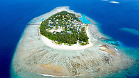 Aerial view of local island Omadhoo, located in Alif Dhaal Atoll, Maldives, Indian Ocean with reef, harbour, local beach and sandbank