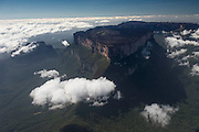 Mount Roraima<br /> Pakaraima Mountains<br /> Near Phillipai<br /> West GUYANA<br /> South America<br /> Mount Roraima is the highest of the Pakaraima chain of tepui plateaus in South America. First described by the English explorer Sir Walter Raleigh in 1596, its 31 km² summit area is bounded on all sides by cliffs rising 400 metres. <br /> Elevation: 9,219′<br /> First ascent: 1884<br /> Prominence: 7,671′<br /> Mountain range: Guiana Shield