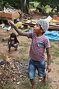 Surui boy and girl whose bodies are painted with traditional blue/black tattoos<br /><br />An Amazonian tribal chief Almir Narayamogo, leader of 1350 Surui Indians in Rondônia, near Cacaol, Brazil, with a $100,000 bounty on his head, is fighting for the survival of his people and their forest, and using the world's modern hi-tech tools; computers, smartphones, Google Earth and digital forestry surveillance. So far their fight has been very effective, leading to a most promising and novel result. In 2013, Almir Narayamogo, led his people to be the first and unique indigenous tribe in the world to manage their own REDD+ carbon project and sell carbon credits to the industrial world. By marketing the CO2 capacity of 250 000 hectares of their virgin forest, the forty year old Surui, has ensured the preservation, as well as a future of his community. <br /><br />In 2009, the four clans and 25 Surui villages voted in favour of a total moratorium on logging and the carbon credits project. <br /><br />They still face deforestation problems, such as illegal logging, and gold mining which causes pollution of their river systems