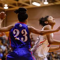 Gallup Bengal Ni'Asia McIntosh (34) breaks through the Las Cruces Bulldawg defense Saturday at Gallup High School.
