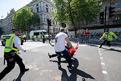 © Licensed to London News Pictures. 15/05/2018. London, UK. Pro-Erdogan and pro-Kurdish protesters clash in Whitehall ahead of the arrival of Turkish President Recep Tayyip Erdogan to Downing Street. President Erdogan will meet with British Prime Minister Theresa May later. Photo credit: Rob Pinney/LNP