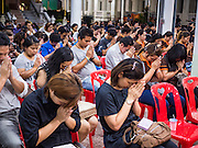 20 AUGUST 2015  - BANGKOK, THAILAND:     More than 100 people gathered at Wat Bang Na Nok in Bangkok for the third day of the funeral rites for  Yutnarong Singraw, a Thai man who was killed in the bombing at the Erawan Shrine in Bangkok Monday. Yutnarong was delivering legal documents when the blast occurred. More than 20 people were killed and more than 100 injured in the blast.   PHOTO BY JACK KURTZ