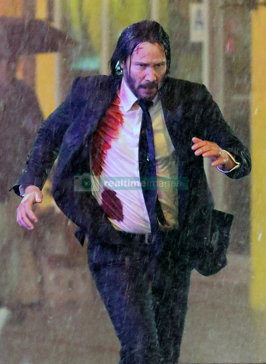 """Keanu Reeves gets soaking wet while sporting bloody wounds as he shot intense running scenes in the rain for the highly anticipated """"John Wick Chapter 3"""" filming in the wee hours of Tuesday morning as he shot for 10 hours drenched from the pouring rain in Downtown Manhattan. 08 May 2018 Pictured: Keanu Reeves. Photo credit: LRNYC / MEGA TheMegaAgency.com +1 888 505 6342"""