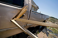 Pieces of lumbar driven through the door of a Ford pickup truck at Bill Foster's home at 2165 East 39th Street in Kearney, Nebraska, May 30, 2008.  Kearney was struck by an EF-2 tornado on May 29. 2008.