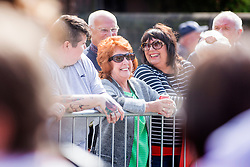 © Licensed to London News Pictures. 20/08/2015. Liverpool, UK. Picture shows well wishers gathering ahead of Cilla Black's funeral at St Mary's church in Wootlon in Merseyside. Photo credit: Andrew McCaren/LNP