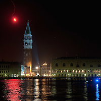 VENICE, ITALY - DECEMBER 31:  A red  signal is fired ahead of the start of the fireworks display  in St. Mark's Square during New Year's Eve street party on December 31, 2011 in Venice, Italy.  Official figures say that around seventy thousand people gathered in St. Mark Square for this year's street celebrations.