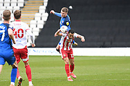 Carlisle United defender George Tanner (2) fouls Stevenage forward Elliott List (17)  during the EFL Sky Bet League 2 match between Stevenage and Carlisle United at the Lamex Stadium, Stevenage, England on 20 March 2021.