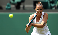 Karolina Pliskova in action on day three of the Wimbledon Championships at the All England Lawn Tennis and Croquet Club, Wimbledon. PRESS ASSOCIATION Photo. Picture date: Wednesday July 4, 2018. See PA story TENNIS Wimbledon. Photo credit should read: Jonathan Brady/PA Wire. RESTRICTIONS: Editorial use only. No commercial use without prior written consent of the AELTC. Still image use only - no moving images to emulate broadcast. No superimposing or removal of sponsor/ad logos. Call +44 (0)1158 447447 for further information.