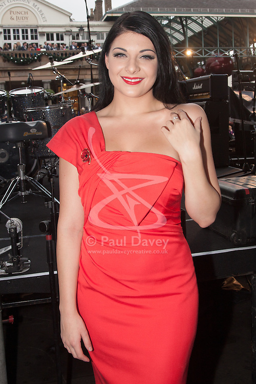 Covent Garden, London, October 30th 2014. They Royal British Legion's Poppy Day in London centred around Covent Garden where bands, choirs, classical and pop musicians entertained crowds as Air Force personnel carrying donation buckets sold poppies, hoping to raise in excess of £1 million. Pictured: Soprano Lucy Kay poses for a picture back stage. She has an upcoming tour planned, supporting Andrea Bocelli.