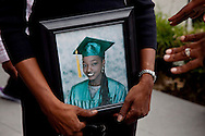 """The mother of Janecia Peters holds an image of her.<br />  LAPD and city officials hold a press conference to announce the capture of the """"Grim Sleeper"""" serial murder suspect, Lonnie David Franklin jr.<br /> Franklin will be charged with 10 counts of murder, and one count of attempted later today."""