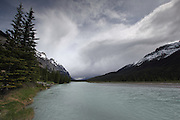 Stormy skies over a river along the Icefields Parkway in Banff National Park, Alberta, Canadian Rockies