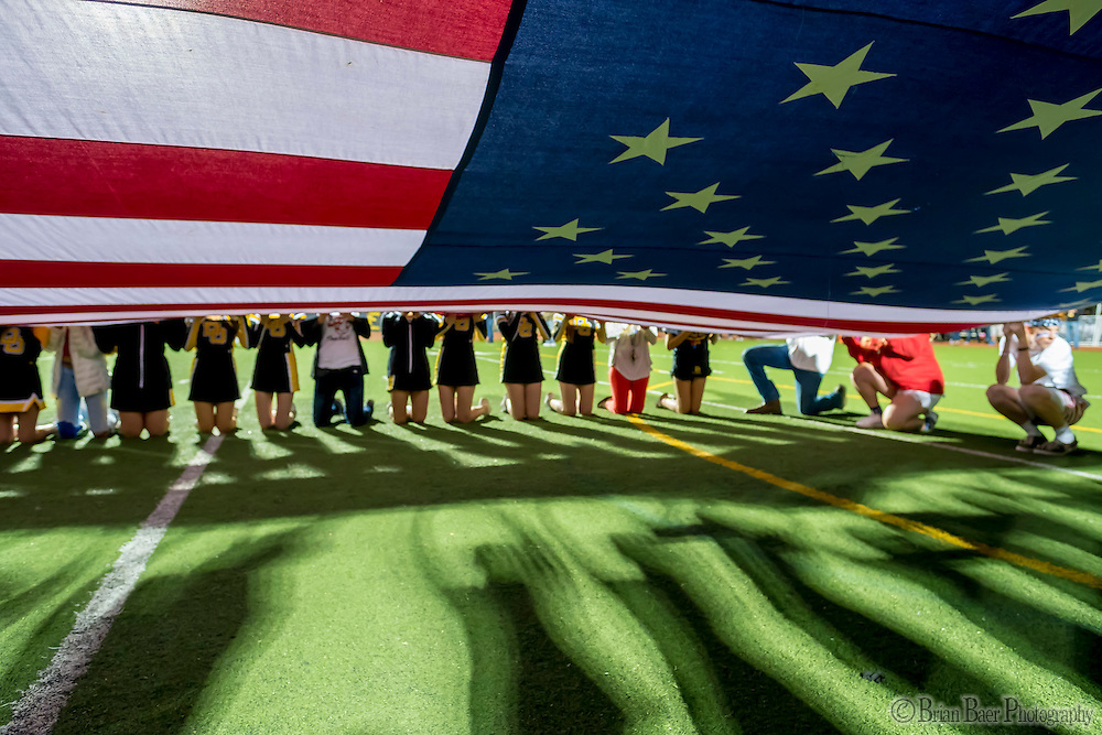 Fans hold the American flag before the game during the first quarter as the Del Oro Golden Eagles varsity football team host the Oak Ridge Trojans, Friday Oct 21, 2016.<br /> photo by Brian Baer
