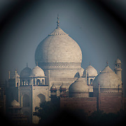 The Taj Mahal viewed through a gilded window in Agra Fort, Agra, India.