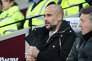 Pep Guardiola, the Manchester City manager looking on from the dugout.  Premier league match, West Ham Utd v Manchester city at the London Stadium, Queen Elizabeth Olympic Park in London on Wednesday 1st February 2017.<br /> pic by John Patrick Fletcher, Andrew Orchard sports photography.
