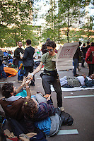 Pslidyinisn Modsb Qashoo passes out pizza to protesters sleeping in Zuccotti Park during the  Occupy Wall Street Protest  in New York...Photo by Robert Caplin.
