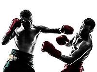 two  men exercising thai boxing in silhouette studio on white background