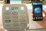 Using your mobile telephone, you scan the QR code, click on the application to rent a battery. One of the drawers opens and a battery comes out to charge your telephone for a specific amount of time, whilst you are in a restaurant. You pay for one hours worth of charge 1Yuan