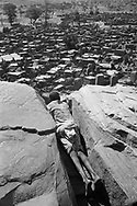MALI. Songo.4/01/1986: Village at the foot of the cliff in Dogon country.
