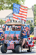 A traditional golf cart and bicycle Independence Day parade is held despite a dramatic rise in COVID-19, coronavirus cases in Charleston County July 4, 2020 in Mount Pleasant, South Carolina. South Carolina is currently number three nationwide in number of infected per population.