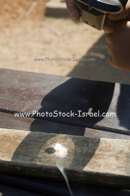 Magnifying glass used to burn wood