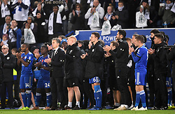 Leicester City manager Claude Puel and players await the arrival of Aiyawatt Srivaddhanaprabha's (not pictured) onto the pitch after the Premier League match at the King Power Stadium, Leicester.
