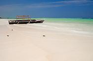 An old boat on Kiwendwa Beach.  Zanzibar, Tanzania
