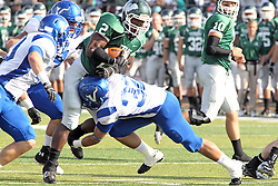 12 October 2013:  Devonte Jones hit by Brian Palmer during an NCAA division 3 football game between the North Park vikings and the Illinois Wesleyan Titans in Tucci Stadium on Wilder Field, Bloomington IL
