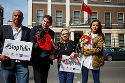 © Licensed to London News Pictures. 07/06/2016. London, UK. ROBERT FLELLO MP, Star Wars actress CARRIE FISHER and LUCY WATSON protest against China's Yulin dog meat festival and hand in an 11 million-signature petition against the festival, outside Chinese Embassy in London on Tuesday, 7 June 2016. Photo credit: Tolga Akmen/LNP
