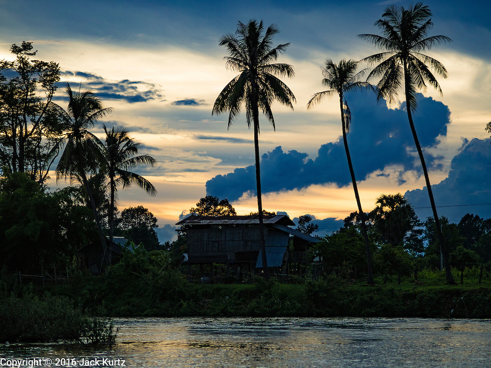 17 JUNE 2016 - DON KHONE, CHAMPASAK, LAOS: Sunset on the Mekong River on Don Khon. Don Khon Island, one of the larger islands in the 4,000 Islands chain on the Mekong River in southern Laos. The island has become a backpacker hot spot, there are lots of guest houses and small restaurants on the north end of the island.        PHOTO BY JACK KURTZ