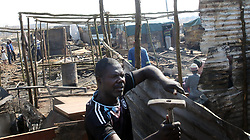South Africa - Pretoria - 21 July 2020 - Plastic View resident McDonald Kiyana rebuilding his house, his car and home burnt down in Saturday's fire. <br />Photo: Jacques Naude/African News Agency(ANA)