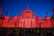 Locals enjoying Brighton Royal Pavilion lit up for the Brighton festival 2016 by Dr Blighty projections on the 25th of May 2016 in Brighton, United Kingdom.  A major outdoor event in the Royal Pavilion Garden inspired by the story of the thousands of Indian soldiers who were treated in the temporary military hospital housed in Brighton Pavilion.
