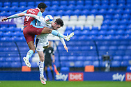 Jacob Bedeau (4) of Scunthorpe United Paul Lewis of Tranmere Rovers battles for possession during the EFL Sky Bet League 2 match between Tranmere Rovers and Scunthorpe United at Prenton Park, Birkenhead, England on 3 October 2020.