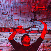 Cory Brandon Puttman of Norma Jean touches the ceiling of The Milestone.